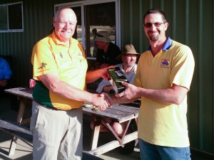 Phill receiving his prize from John Baxer